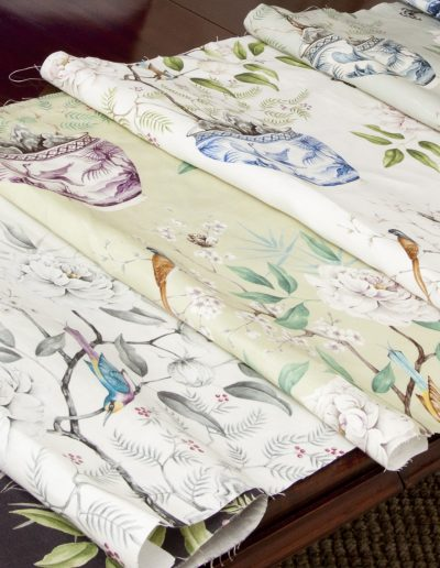 Different colourways of Romey's Garden fabric